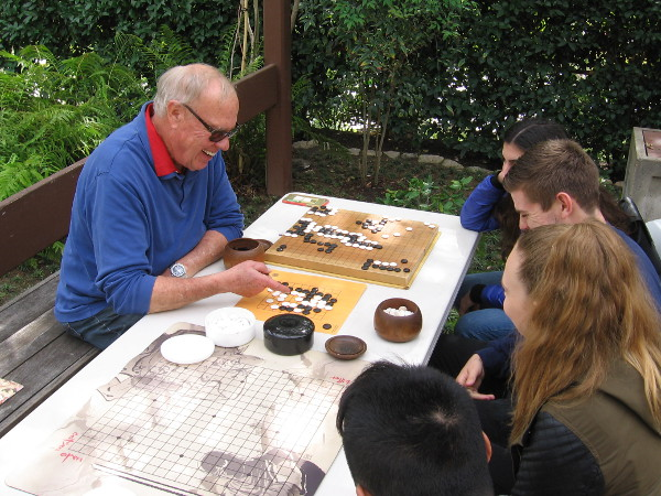 The game of go is played near the Japanese Friendship Garden's koi pond. Funny--by sheer coincidence I watched A Beautiful Mind last night. This mental game bookends the touching film.