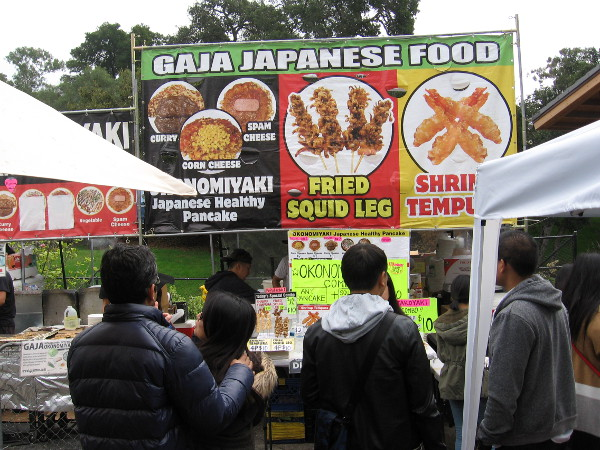 Checking out a big selection of Japanese food, including fried squid leg and shrimp tempura.