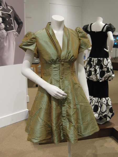 This 1940's style dress was created by student designer Anna Acosta. In that decade garments were often designed to soften a woman's shape, create a sense of elegance.