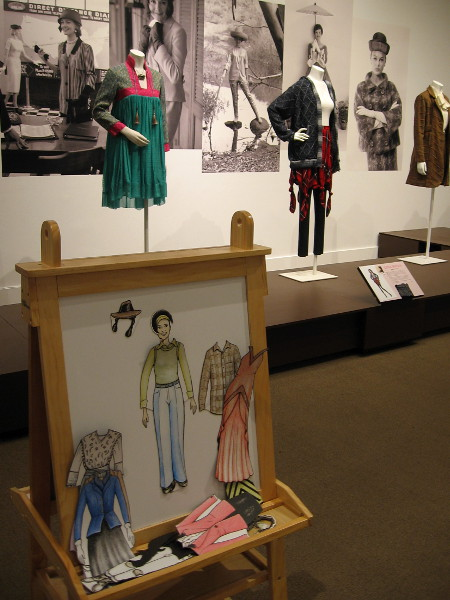 An activity center at the exhibition encourages kids to try their own hand and eye at fashion design. A nearby nook is the setting for fashion demonstrations by students and instructors from the San Diego Mesa College Fashion Program.