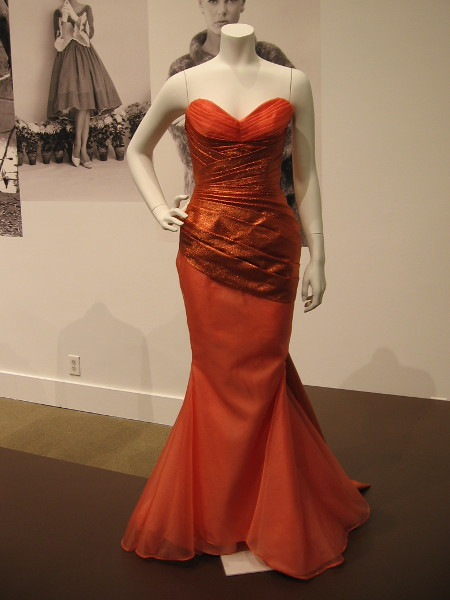 This draped nylon and taffeta gown reflects the Golden Age of Hollywood during the 1930's and the Great Depression. Like an uplifting dream in those difficult times. Created by student designer Stephanie Castro.
