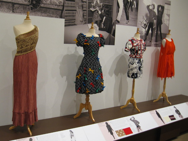 Dresses from the past nine decades are like a timeline representing evolving culture and various impacts of technology.