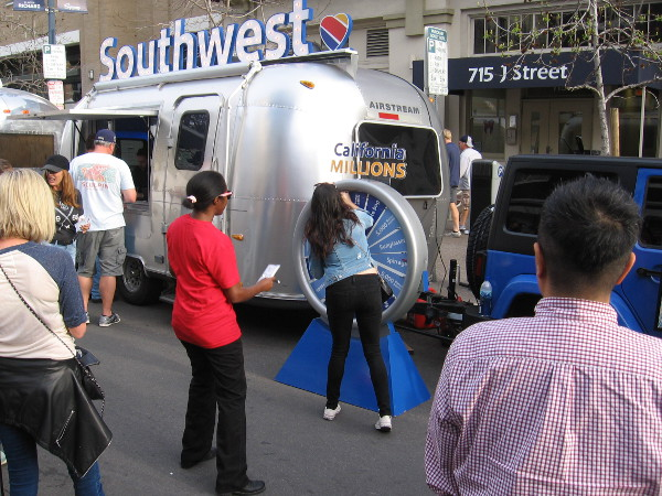 Lots of people were lined up to spin a California Millions prize wheel.