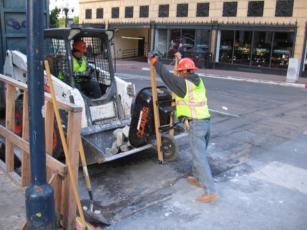 Working on the street near Sixth and Broadway.