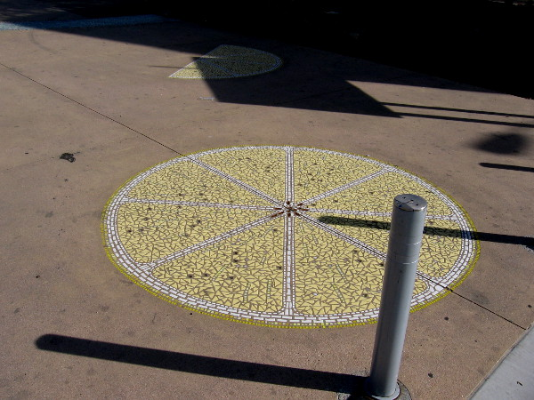 A walkway between the Celsius residential building and the Lemon Grove Trolley Depot contains tile mosaic lemon slices!