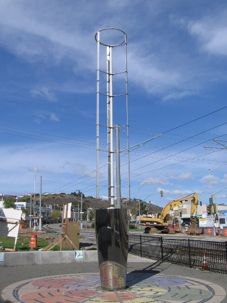 What appears to be wind-driven public artwork near Celsius and the trolley station generates electricity.