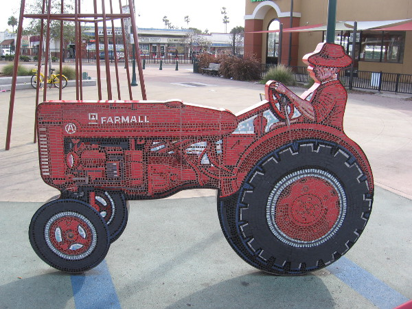 Both sides of this fun public art tractor are composed of small tiles.