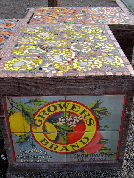 A nearby bench in the park appears like a crate once used by the Lemon Grove Fruit Growers Association!