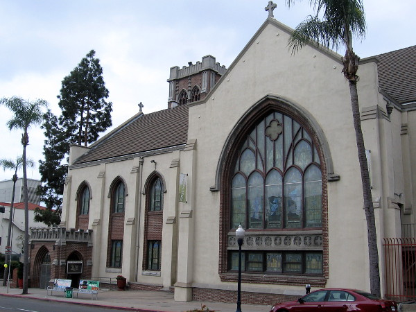View of the First Presbyterian Church of San Diego from Fourth Avenue. The stained glass window shines its light into a very beautiful sanctuary.