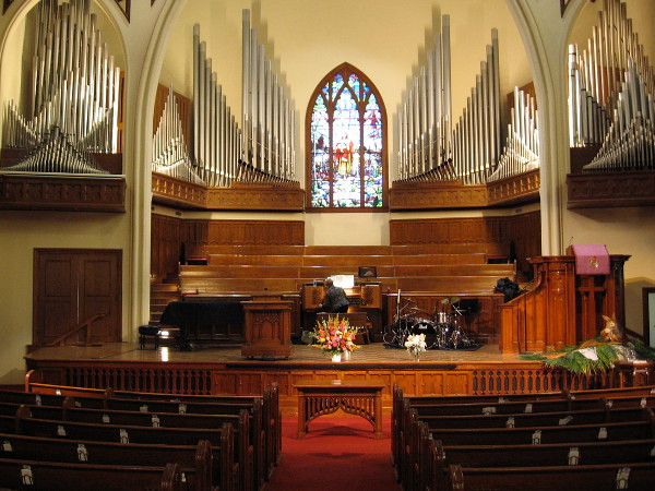 The church's nearly 6,000 pipe Casavant organ rises like rays of silvery light crowning the chancel.