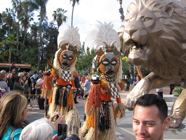 These cool costumed stilt-walkers circled around from the other side!