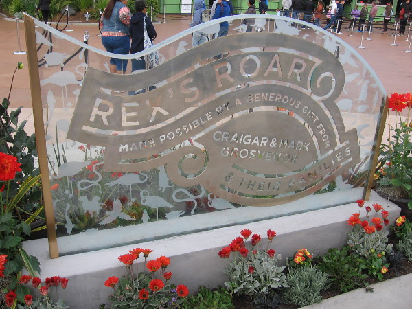 Another nearby sign indicates Rex's Roar was made possible by a generous gift from Craig and Mark Grosvenor and their families.