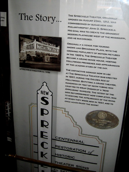 A sign describes the Spreckels Theatre story. In the 1920's, it was transformed into a grand movie house, hosting Hollywood premieres and the leading stars of the day.
