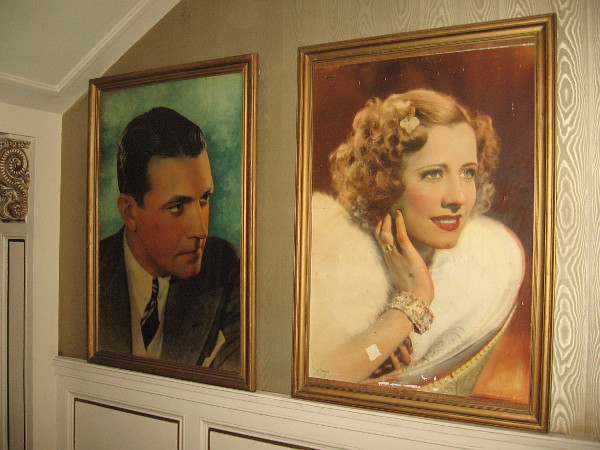 Portraits of Hollywood stars left of the front counter.