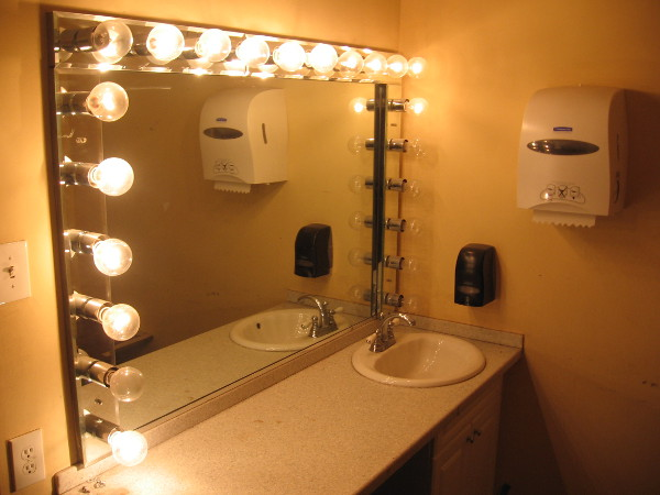 A quick peek into a modest suite to the side of the stage. A mirror, sink and restroom are reserved for the biggest stars.