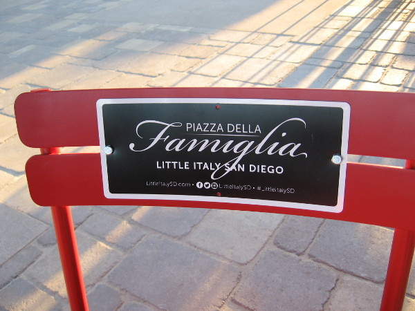 One of many seats at the tables in Piazza della Famiglia.