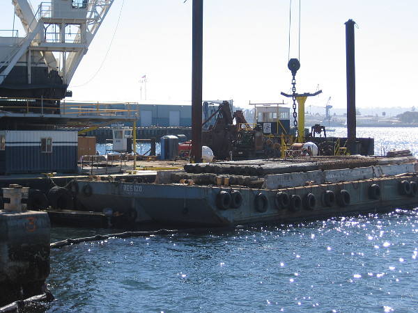Many extracted piles were already stacked on the barge beside the crane when I walked by.