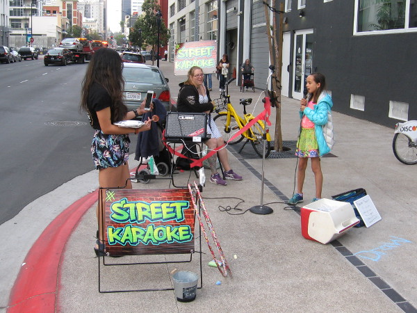 Some folks were singing their hearts out doing Street Karaoke.