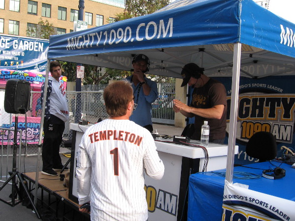A Padres fan wearing a Garry Templeton jersey is interviewed live on a Mighty 1090 sports radio program.
