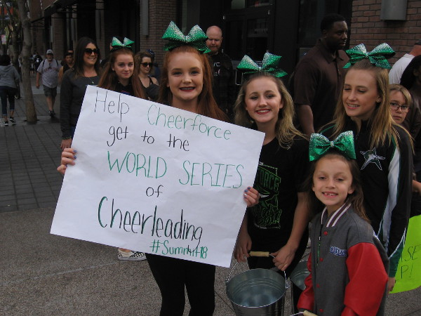 Cheerforce San Diego is trying to get to the World Series of Cheerleading. Read their sign if you'd like to help!