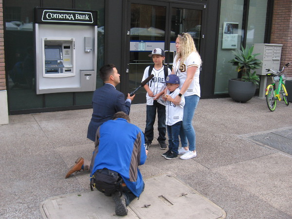 A family of Padres fans is interviewed at the Opening Weekend Block Party.