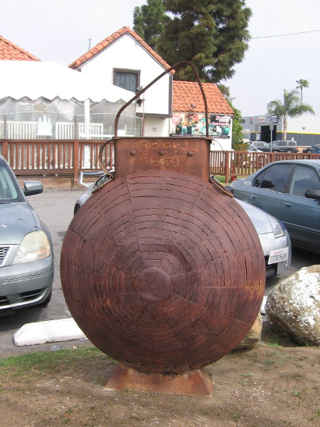 An unusual rusted metal sculpture near the front of Fiesta Hall Chula Vista on H Street.