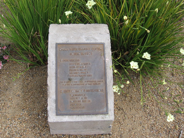 A small plaque among some flowers. Chula Vista Transit Center. November 1981.