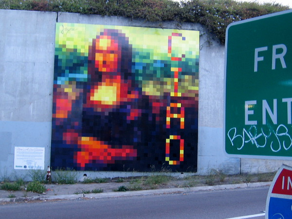 An abstract Mona Lisa mural greets cars with a large CIAO as drivers head onto southbound I-5 from Grape Street!