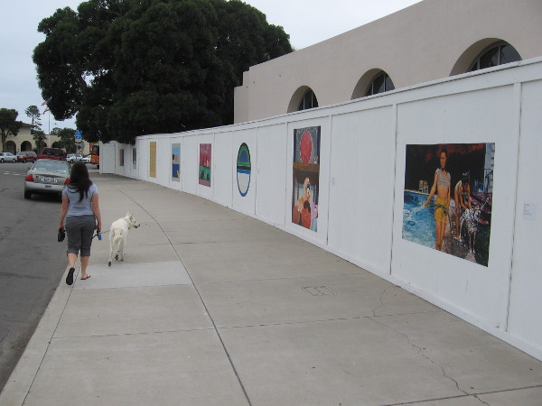 Images from the collection of the Museum of Contemporary Art San Diego on a construction fence at the La Jolla campus.