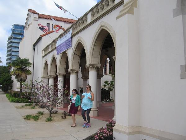 Ladies exit through an arcade of elegant columns.