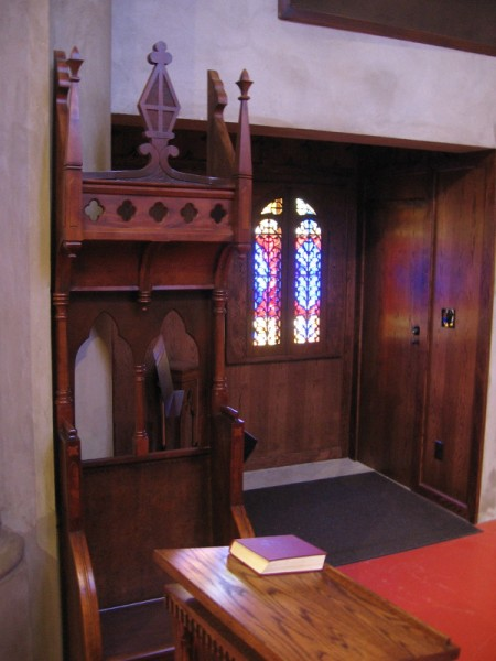 The cathedra, or bishop's throne, off to one side.
