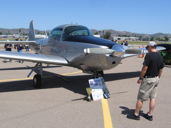 Someone looks at a restored North American L-17 aircraft on display at Gillespie Field during a special Air Group One event.