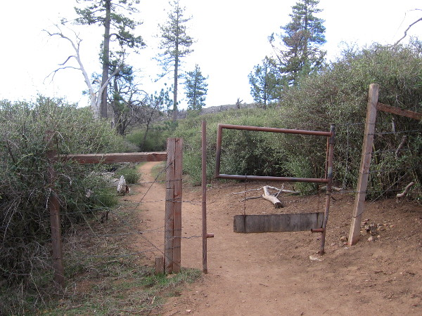 A swinging gate on the trail. Sometimes cattle are herded up in these mountains.