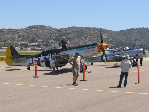 People were riding vintage military planes that helped the Allies to win World War II.