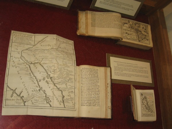 A display case at the Map and Atlas Museum of La Jolla includes geographic playing cards from the early 18th century.