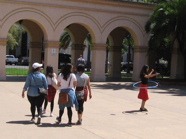 Someone plays with a hula hoop in the Casa del Prado's outer courtyard.