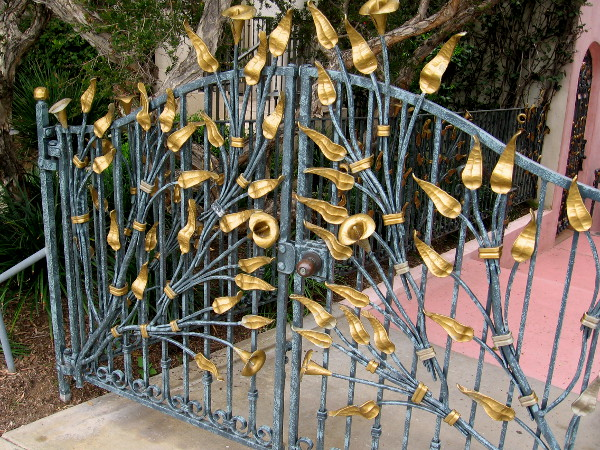 One of the most stunning gates I've ever seen. Golden leaves and blooms seem to grow through it.