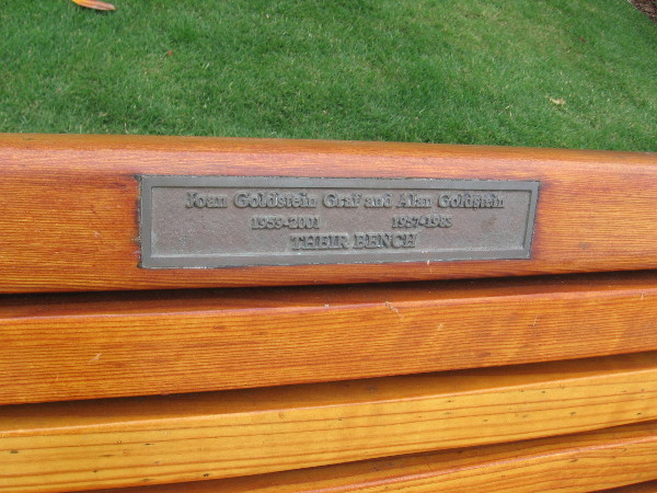 By the sidewalk. Joan Goldstein Graf and Alan Goldstein. Their bench.