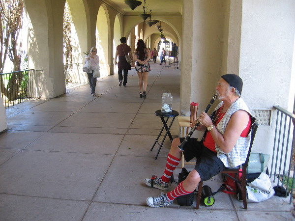 Playing sprightly music for passersby near the House of Hospitality.