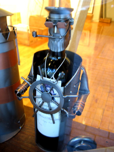 A wine bottle has been converted into a salty sea captain at the Michael J Wolf Fine Arts gallery.