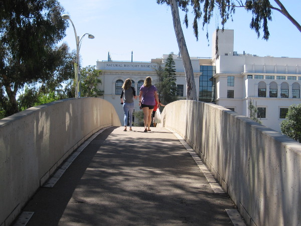 Walking over the Park Boulevard pedestrian bridge from the rose and desert gardens, back toward the San Diego Natural History Museum and Plaza de Balboa.