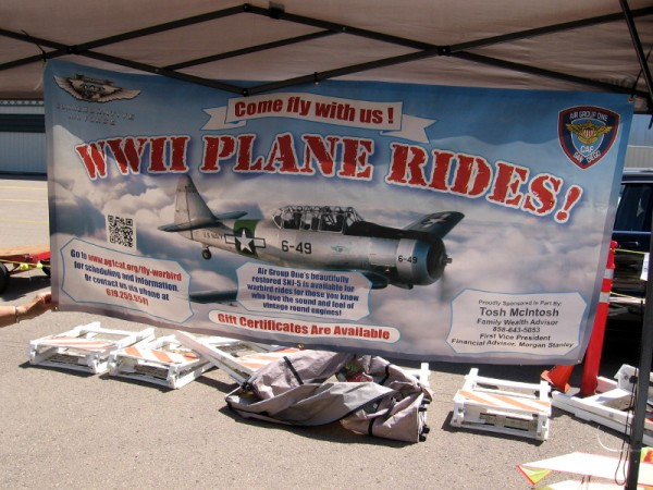 A banner explains that Air Group One's restored SNJ-5 is available for warbird rides for those who love the sound and feel of vintage round engines.