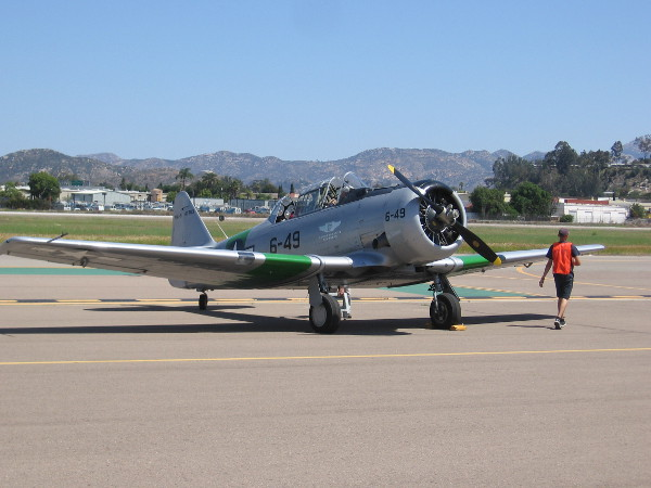 """Air Group One's historic 1943 SNJ-5 """"Sassy"""" on the tarmac at Gillespie Field."""