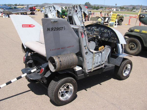 This golf cart was modified to look like a tiny jet airplane! It even has a tailhook!