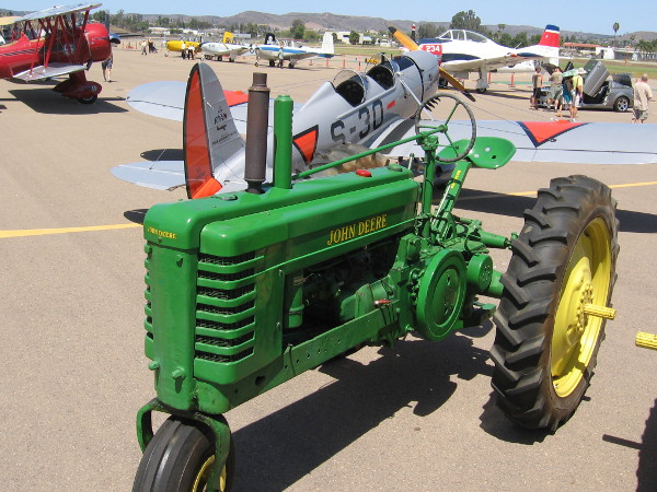 I was surprised to see several old farm tractors out on display among the airplanes!