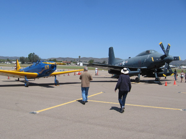 Visitors to Air Group One's first ever Warbird Expo and Militaria Swap Meet check out more vintage airplanes at Gillespie Field.