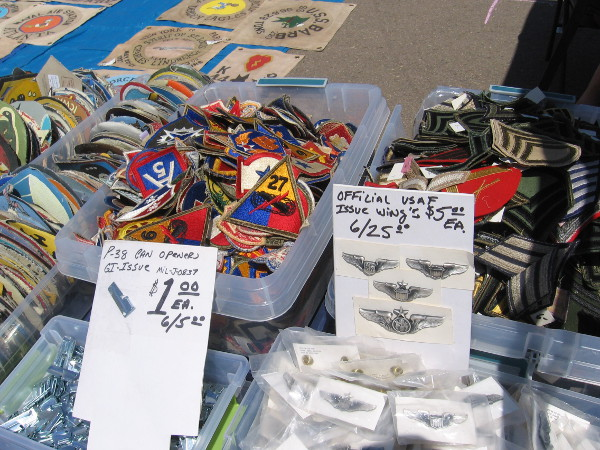 Aviation souvenirs and stuff for sale at the swap meet included pins and patches.