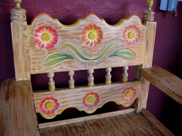 Cheerful flowers decorate the back of a wooden chair at Fiesta de Reyes in Old Town San Diego.