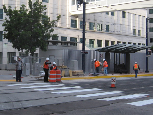 Workers prepare the new Courthouse trolley station on C Street. Starting April 29, 2018, the Orange Line will terminate here.