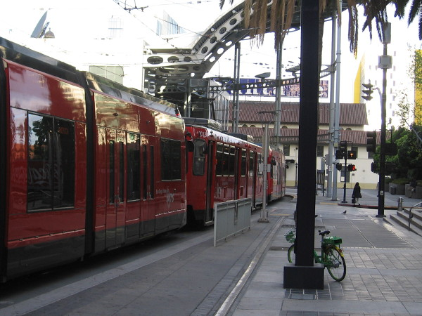 I'm passed by a Blue Line trolley as it enters America Plaza.